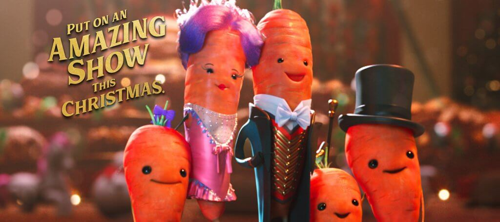 Aldi's Kevin the Carrot and his family with text 'Put on an amazing show this Christmas'